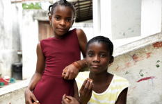Elina (11), left, and her best friend Faria (12), right, near their homes in Cabo Delgado region in northern Mozambique. Elina's house was badly damaged and Faria's house was completely destroyed when Cyclone Kenneth hit her village in April 2019.